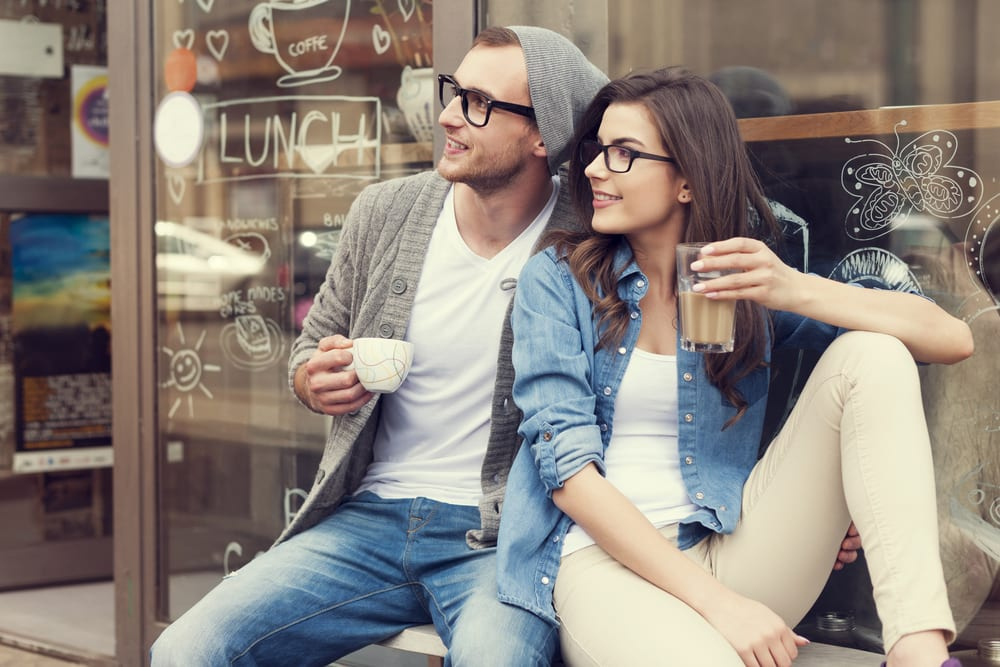 Portrait of stylish couple at outside of cafe - How to ask a Pisces man out